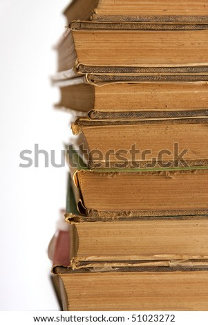 A stack of old books on white background. - stock photo
