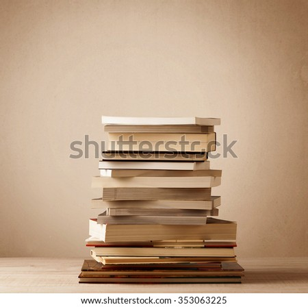 A stack of old books with vintage background - stock photo