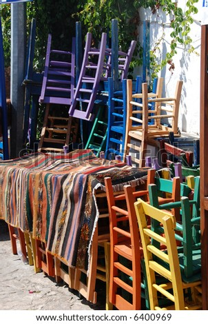 A stack of old colorful chairs outside a restuarant in Kas,Turkey