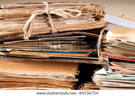A stack of old files yellowing in an archive - stock photo