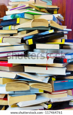 a stack of opened and closed fully books - stock photo