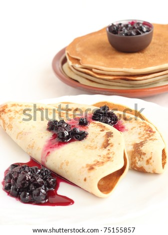 A stack of pancakes on a plate on white background - stock photo