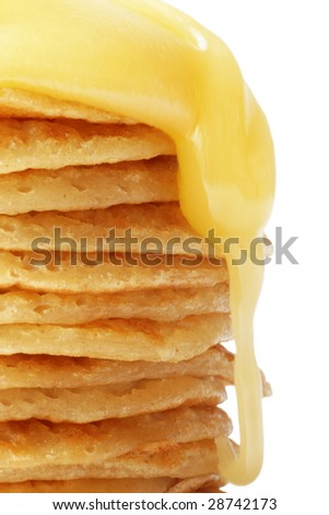 A stack of pancakes with honey.