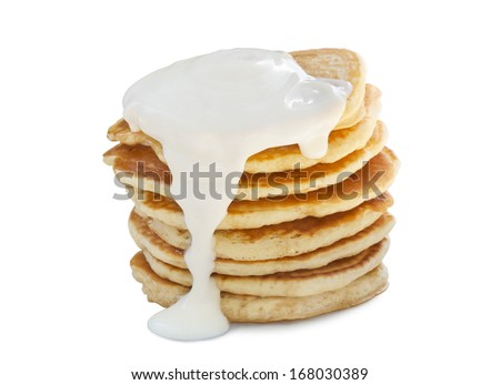 A stack of pancakes with sour cream. Isolated on white. - stock photo