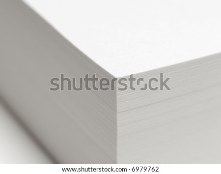 a stack of paper sheets with DOF - focus is on the corner.