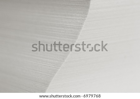 a stack of paper sheets with DOF - focus is on the corner. - stock photo