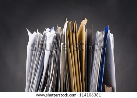 A stack of papers - stock photo