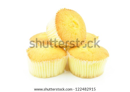 A stack of plain muffins on a white background. - stock photo