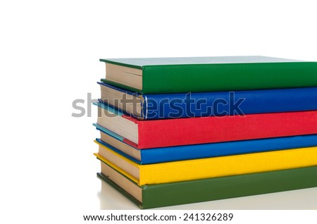 A stack of primary colored textbooks on a white background - stock photo