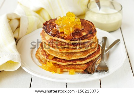 A Stack of Pumpkin Pancakes Topped with Pumpkin-in-Syrup Preserves - stock photo