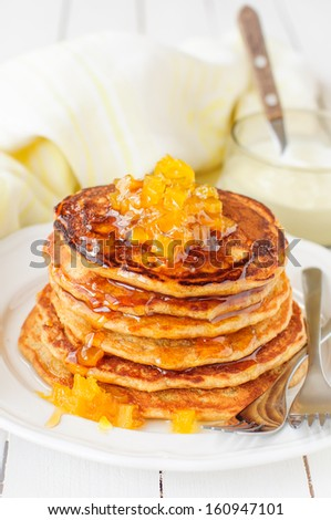 A Stack of Pumpkin Pancakes Topped with Pumpkin-in-Syrup Preserves, copy space for your text - stock photo