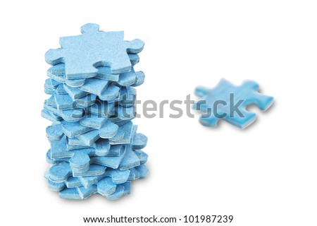 A stack of puzzles on a white background. - stock photo