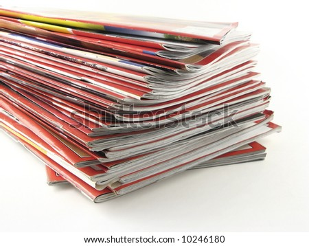 A stack of red magazines against white background.