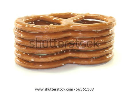 a stack of salted pretzels on a white background