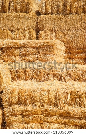 A stack of scattered hay bales - stock photo