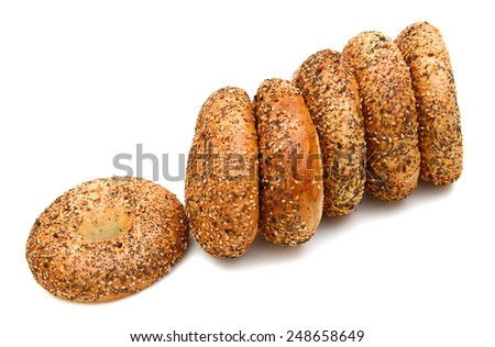 a stack of sesame brown bagels - stock photo