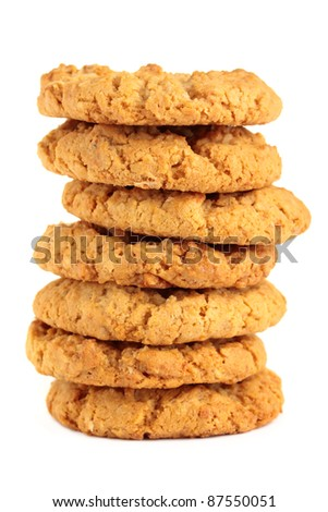"A stack of sweet biscuits, known in Australia as ""ANZAC"" biscuits. Isolated on a white background. - stock photo"