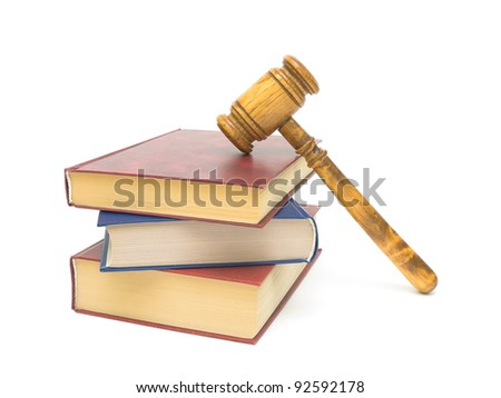 a stack of three books and gavel on white background close-up