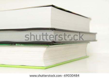 A stack of three books, closeup photo - stock photo