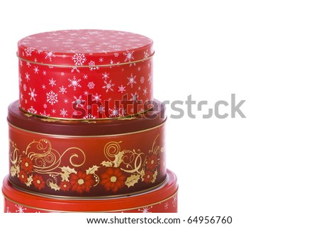 A stack of three Christmas holiday cookie tins - stock photo