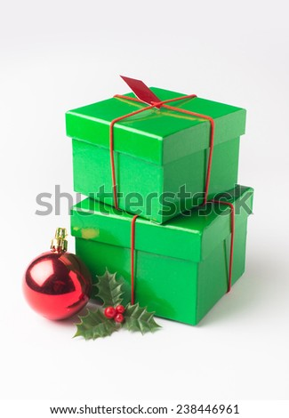 A stack of two green festive gift boxes with christmas decorative elements on white background. - stock photo