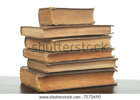A stack of very old, worn, yellowed books