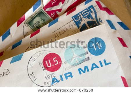 A stack of vintage envelopes containing US Air mail stamps