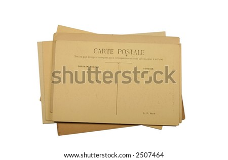 A stack of vintage French postcards - stock photo