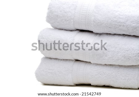 A stack of white towels on white - stock photo