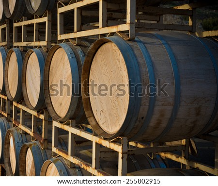A stack of wine barrels at a vineyard - stock photo