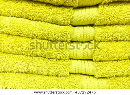 A stack of yellow towels as a background - stock photo