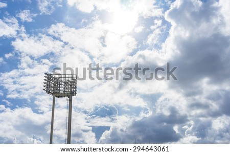 a stadium floodlight with metal pole - stock photo