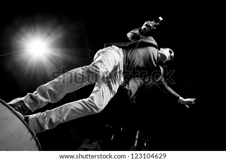 A stagediving Dj at a concert. - stock photo