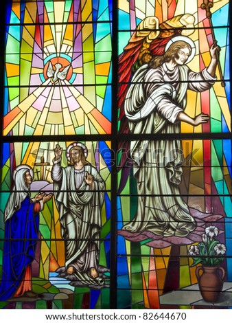 A stained glass displaying saints in a catholic church