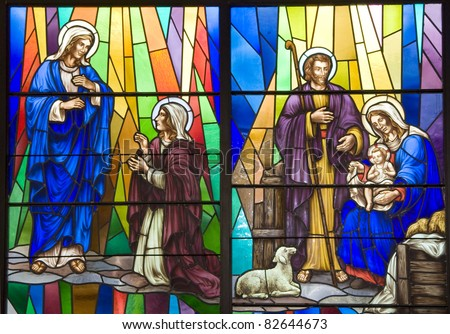A stained glass portrait of Christ being born - stock photo