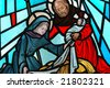 A stained glass window of the nativity. - stock photo