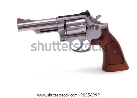 A stainless steel .357 caliber handgun with a 4 inch barrel isolated on a white background.