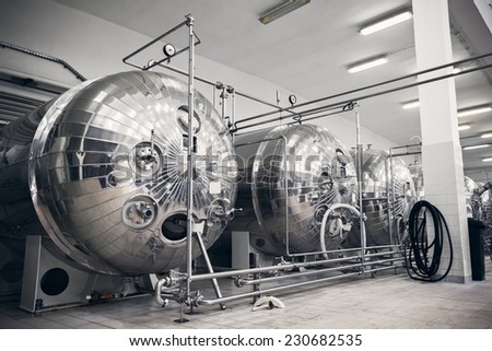 a stainless steel container with a liquid plant - stock photo