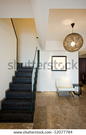 A staircase and entry way in a beautiful home interior. - stock photo