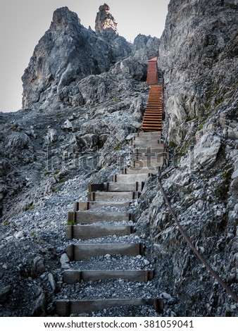 a stairway called Tritt leads through rocks in the Swiss alps near Arosa
