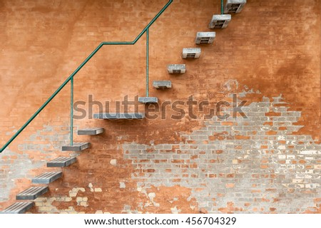 A stairway on a brick wall - stock photo