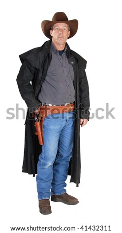 A standing cowboy. - stock photo