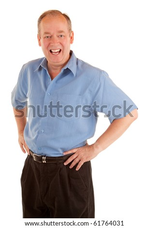 A standing man is smiling at the camera. - stock photo