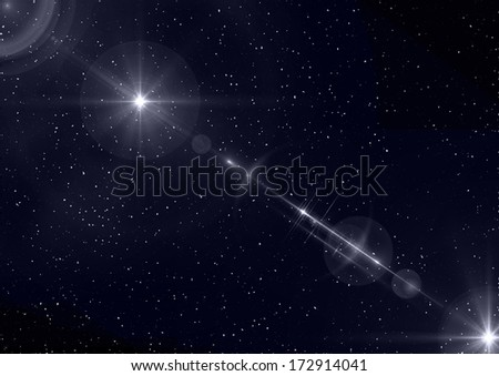 A starry night sky with lens flare for use as a design element or as a background. - stock photo