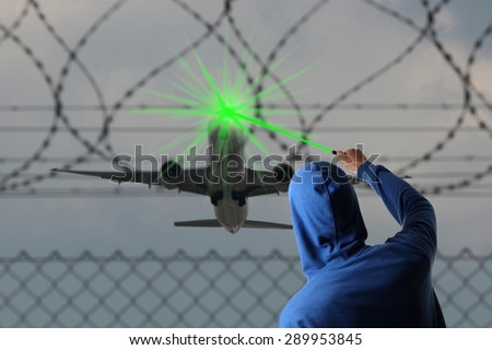 A Starting Airplane blinded with a Laser pointer - stock photo