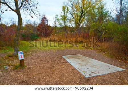 A Starting Tee in the Game of Disk Golf - stock photo