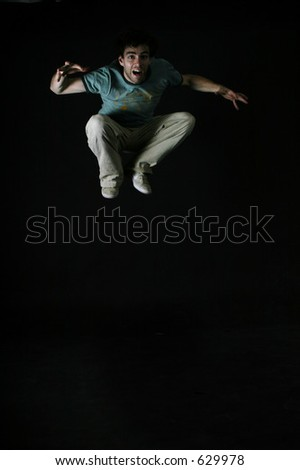 A startled man jumping - stock photo