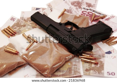 a stash of drugs gun and money showing a dangerous cost to life against a white background - stock photo