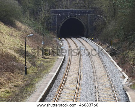 A station on a railway line in the countryside - stock photo