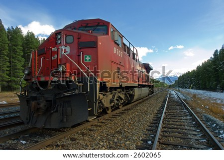 a stationary train in the Canadian Rockies - stock photo